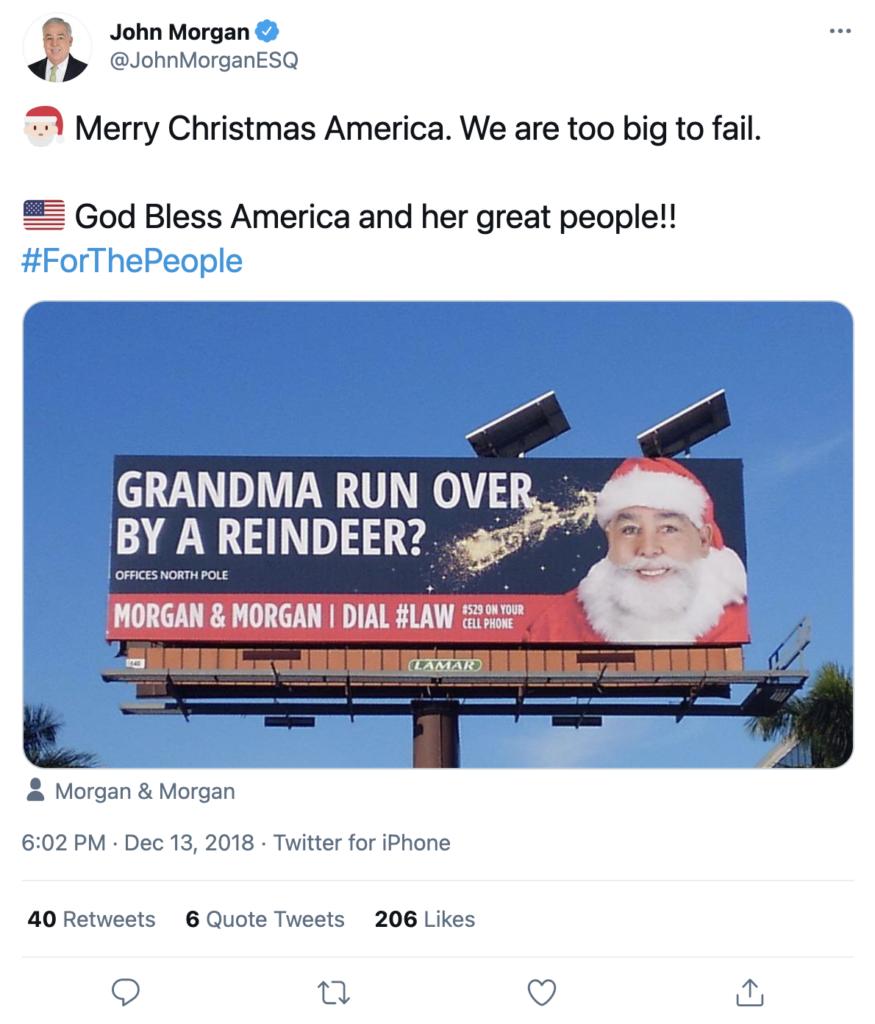 "A screenshot of a tweet by John Morgan. The tweet features a billboard with John Morgan as Santa Claus and the copy ""Grandma Run Over By A Reindeer?"""